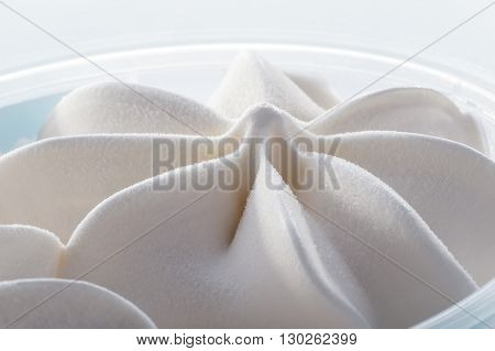simple white ice cream in  plastic box macro shot