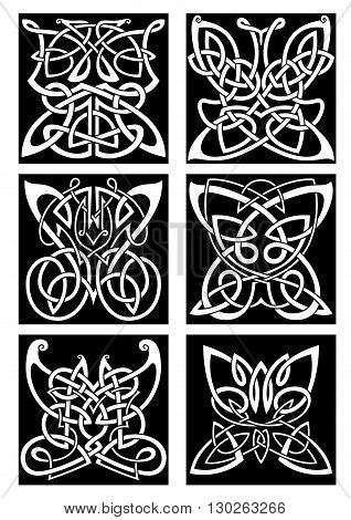 Tribal butterflies symbols for tattoo or t-shirt print design with infinity swirling celtic knot patterns arranged into beautiful butterflies with open wings