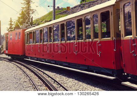 Retro passenger train departs from Schynige Platte to Interlaken. Switzerland.