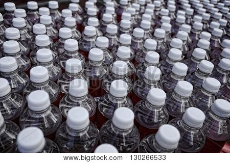 Table top with large amount of water bottles ready for taking