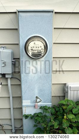JOLIET, ILLINOIS / UNITED STATES - NOVEMBER 5, 2015: A GE Watthour Meter measures usage of electricity in a home in the Wesmere Country Club neighborhood of Joliet.