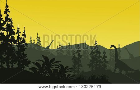 Silhouette of brachiosaurus and spruce with yellow sky
