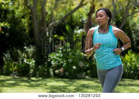 Woman running at park