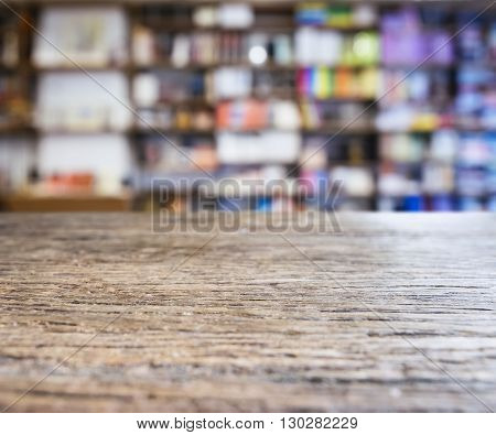 Table top Counter with Blurred Bookshelf Bookshop Retail Background