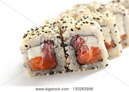 Maki Sushi - Roll made of Smoked Salmon, Cream Cheese and Pepper inside. Sesame ouside