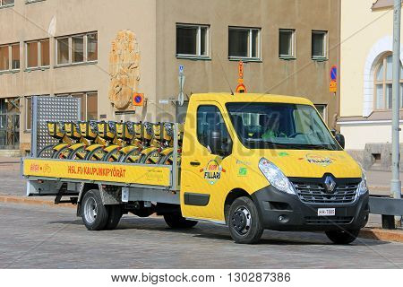 HELSINKI FINLAND - MAY 10 2016: New Renault Master flatbed van transports City Bikes in Central Helsinki. City bikes are shared-use bicycles that can be borrowed for a fee in central Helsinki.