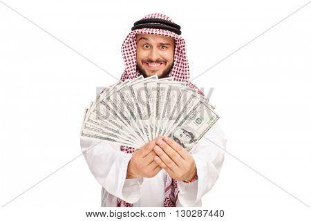 Joyful Arab holding a stack of money isolated on white background