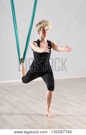 Woman Doing Aerial Yoga Workout For Balancing