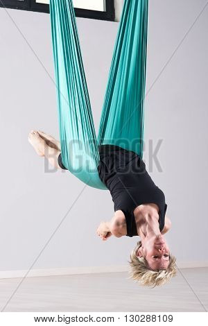 Female Athlete Doing Aerial Yoga Arm Stretches
