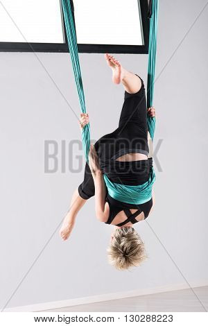 Woman Performing An Aerial Yoga Somersault