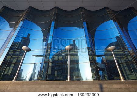 The glass facade of curved blue glass