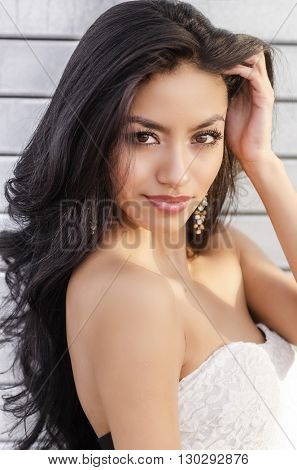 Beautiful exotic young woman with long dark hair