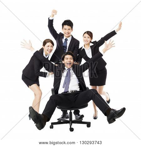happy Business group push colleague sitting in chair