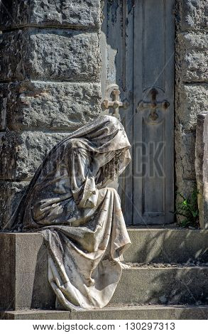 Widow While Crying Marble Statue Outside A Tomb