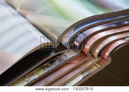 Close-up of stack of colorful magazines. Press news and magazines concept