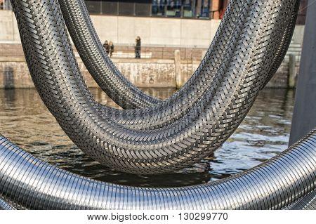 giant harbor metallic flexible pipe detail close up