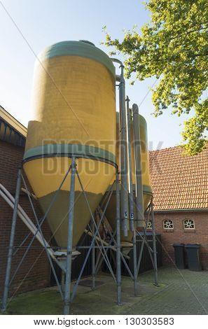 two silos on a dairy farm for animal food storage