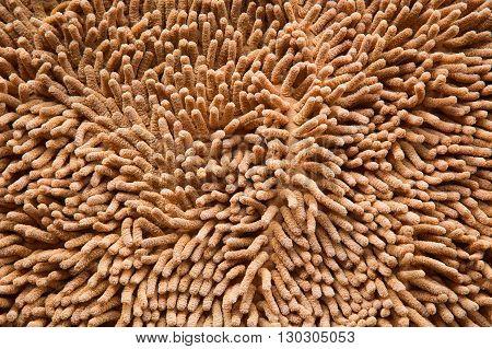 orange cleaning doormat or carpet texture background