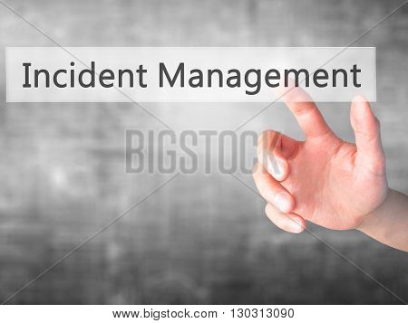 Incident Management  - Hand Pressing A Button On Blurred Background Concept On Visual Screen.
