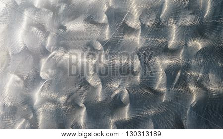 Concentric brushed metal sheet polished and shiny alloy background