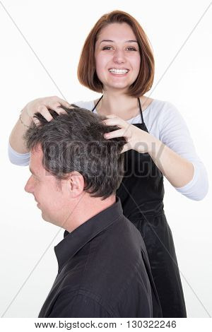 Male Getting A Massage While Having Hair Cut At Salon By Hairdresser