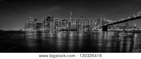 new york manhattan night view from dumbo brooklyn in b&w