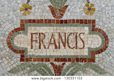 Pope Francis name in red mosaic patchwork detail