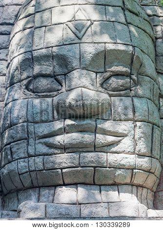 Maya Aztec style stone statue detail close up