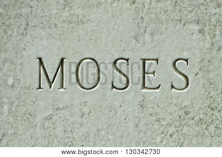 moses inscription on white marble close up