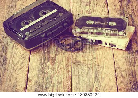 old cassette player audio cassette on a wooden table retro style