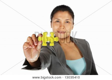 Businesswoman Showing Jigzaw Puzzle Piece