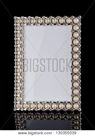 frame inlaid with pearls on black background