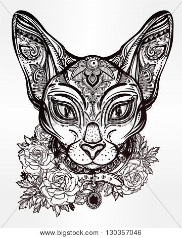 Vintage ornate cat head with tribal ornaments and floral collar. Character tattoo design for cat lovers, artwork for print and textiles. Isolated vector illustration.