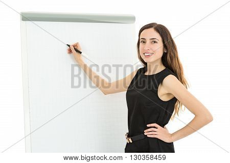 Female teacher writing on a white board. Isolated on white background.