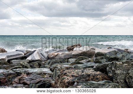 Sea In Tempest On Rocks Shore