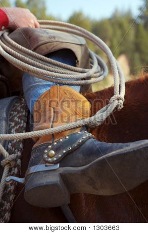Cowboy Boots And Rope Close Up