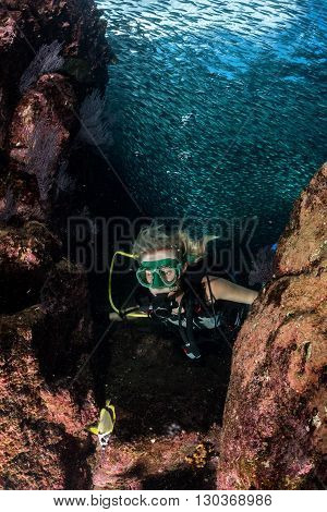 Beauty Blonde Diver Girl Looking At You While Swimming Underwater