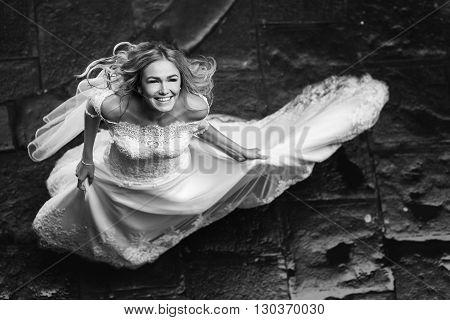 Romantic Blonde Bride Posing In Italian Column Street, From Above B&w