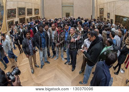 Paris, France - April 30, 2016 - Mona Lisa Painting Louvre Hall Crowded Of Tourist