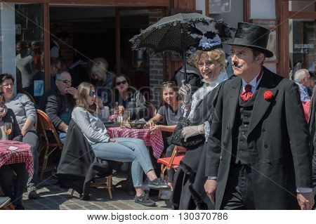 Paris, France - May 1 2016 - Old Dressed Man And Woman In Montmartre Crowded Of People For Sunday Su