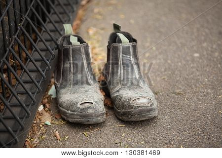 Pair of Labourers Work Boots left abandoned on a city sidewalk