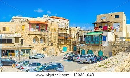ACRE ISRAEL - FEBRUARY 20 2016: The residential neighborhood of the old Akko with medieval housing and car parking on February 20 in Acre.