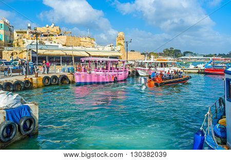 ACRE ISRAEL - FEBRUARY 20 2016: The boat trips are very popular attraction in old Akko the medieval town looks great from the sea on February 20 in Acre.
