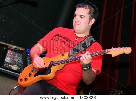 Rockstar Playing Guitar On Stage