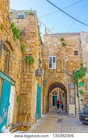 ACRE ISRAEL - FEBRUARY 20 2016: The old quarters of Akko hides many winding streets with the narrow passes chaotic ways and other places of interest on February 20 in Acre.
