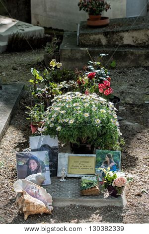PARIS FRANCE - MAY 2 2016: Monumental Pere-Lachaise cemetery Paris. Each year thousands fans and curious visitors come to pay homage to celebrities grave. Susan Garrigues was killed by terrorist in bataclan attack of 13 november 2015