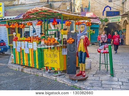 ACRE ISRAEL - FEBRUARY 20 2016: The wooden kiosk offers orange fresh in the old city of Akko on February 20 in Acre.