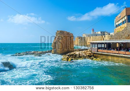 ACRE ISRAEL - FEBRUARY 20 2016: The ruins in the former Crusader harbor nowadays are the favorite tourists' selfie background on February 20 in Acre.