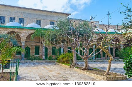 ACRE ISRAEL - FEBRUARY 20 2016: The complex of Al-Jazzar mosque innclude the scenic garden surrounded by the buildings of Islamic theological academy an Islamic court and a public library on February 20 in Acre.