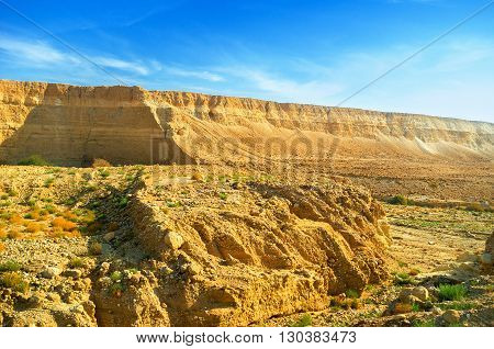 The unique landscape of Negev desert with the steep rocky slopes Israel.